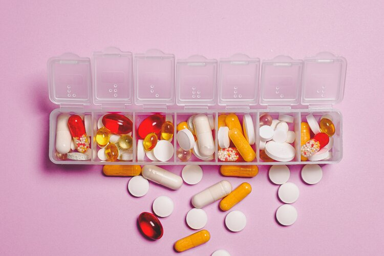 clear-plastic-container-and-medicine-capsule-3683051.jpg