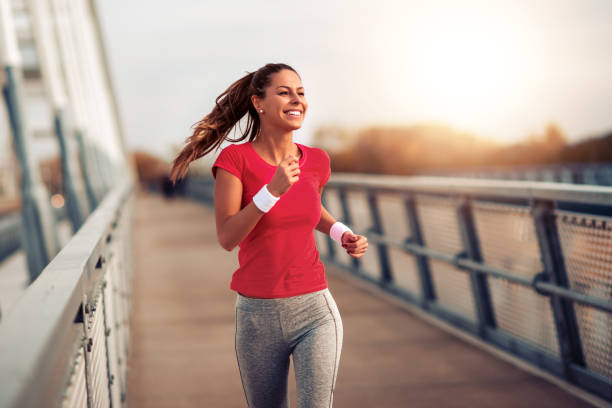 woman running happy with knee brace