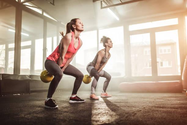 Women with kettlebells crossfit knee brace