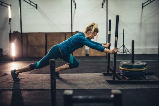 woman pushing weights crossfit knee brace