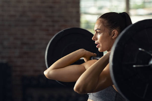woman lifting weights crossfit knee brace