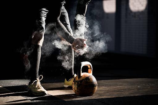 kettlebell gym workout in knee brace