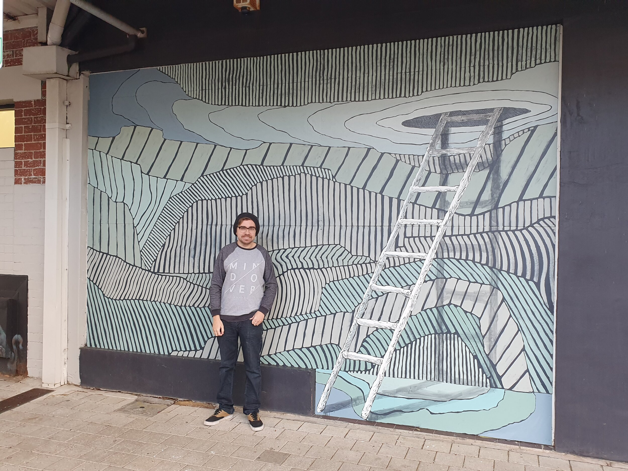 Dylan Nietzreba worked with guidance of his mentor, Andrew Frazer, on a mural in Bunbury