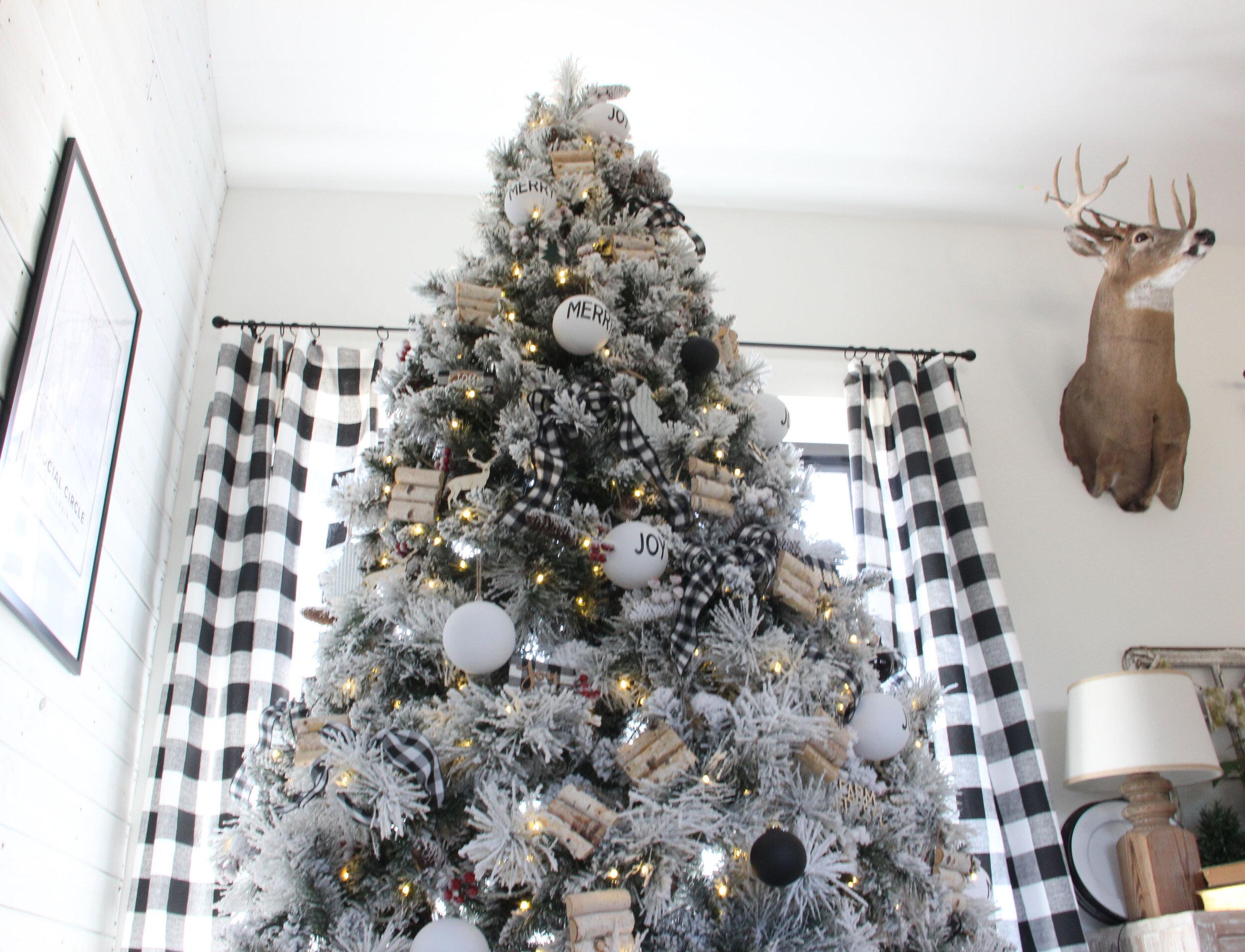 A Cozy Snow Flocked Farmhouse Christmas Tree The Rustic Boxwood