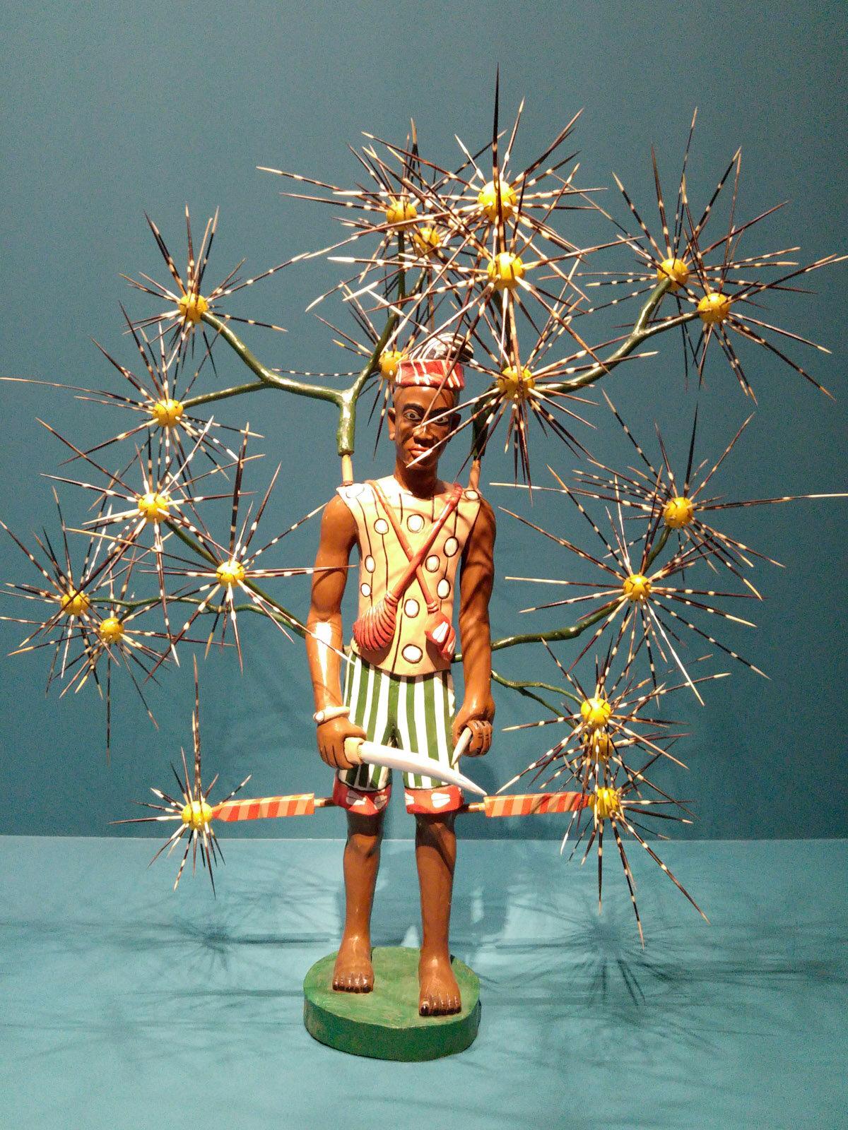 约翰·戈巴(John Goba),木头和豪猪钉雕塑