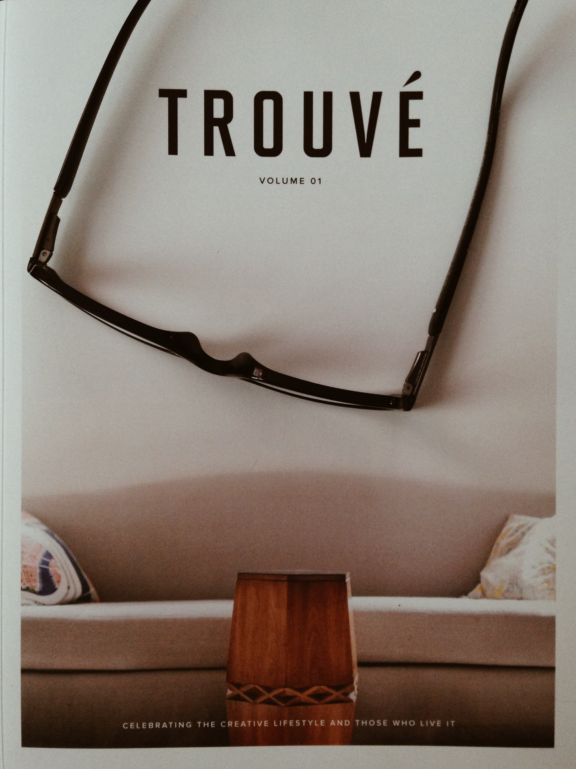 The cover of Trouvé shown with my reading glasses.