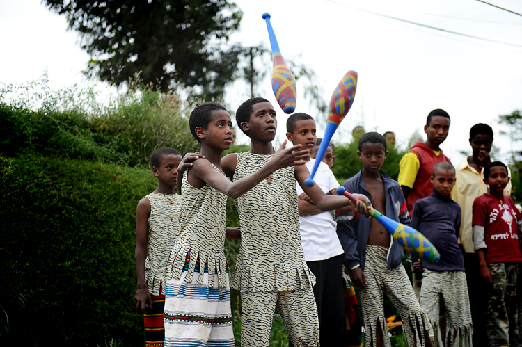 """Boys juggle together at the   Mary Joy Aid Through Development  . This particular segment of their performance was preceded by a mime, where the boy on the right """"taught"""" the boy on the left to juggle.  Apparently he's a good learner."""