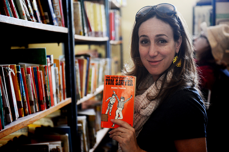 Liz  , recognizing a book at the Mojo Secondary School library. The kids are taught in both English and Amharic.