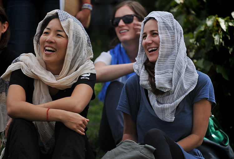 Christine Koh   and   Liz   laughing and generally enjoying life (in their  FashionABLE scarves ,  natch !).     (Speaking of which! Last night, the ONEMoms heard from the founder of FashionABLE, Barrett Ward, who said that as a result of all the scarves that were bought from people who read the ONEMoms posts this past month, FashionABLE is able to hire three more women -- that's three more women off the street, who no longer have to turn to a life of prostitution to feed themselves and their children!  You  did that! You should be seriously, seriously proud.      These scarves are magic , I tell you.)