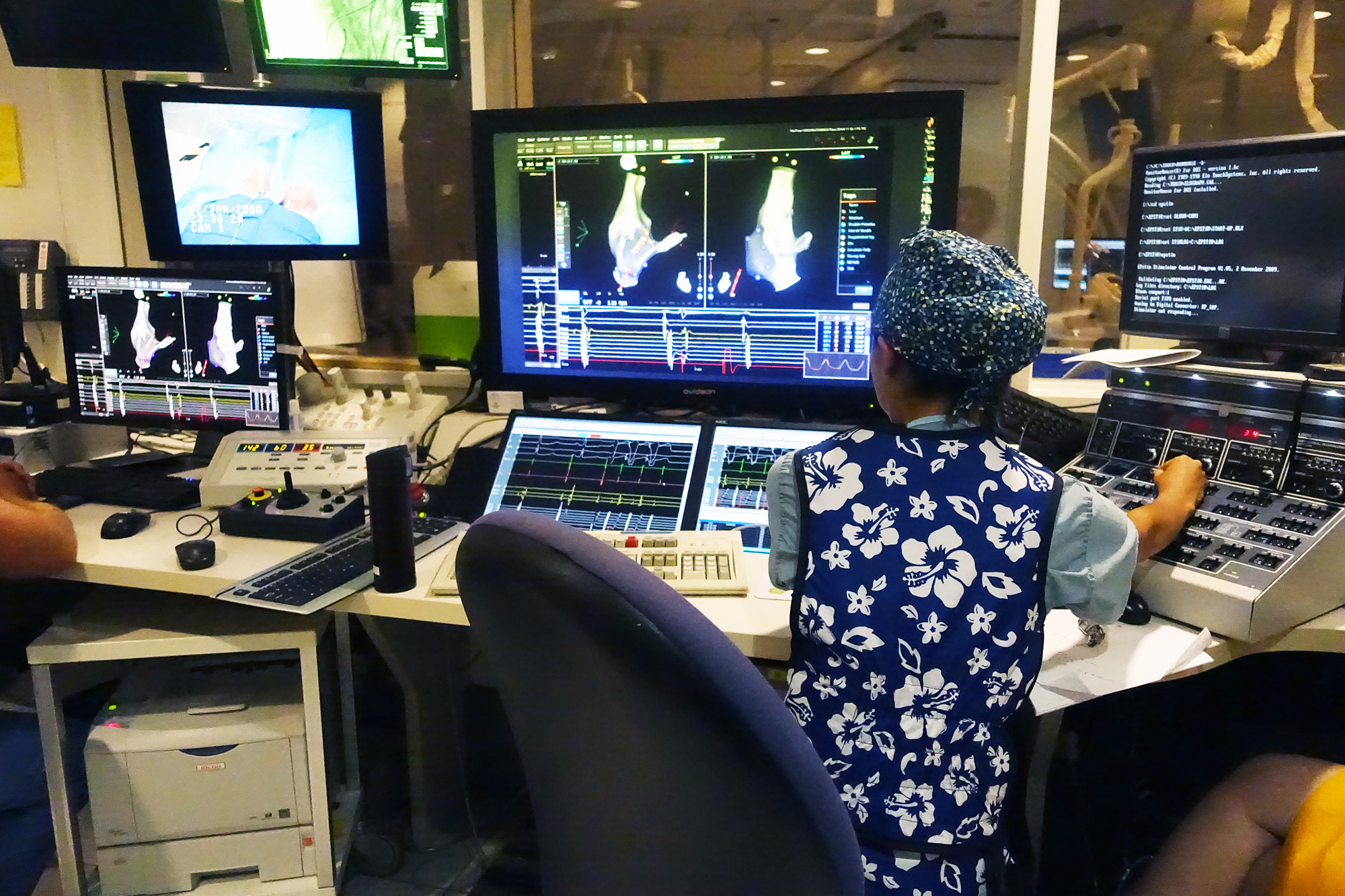 A physician at   Texas Children's Hospital   performs heart surgery on a 3-year-old patient,   using computers and a joystick   (!), August 2014.