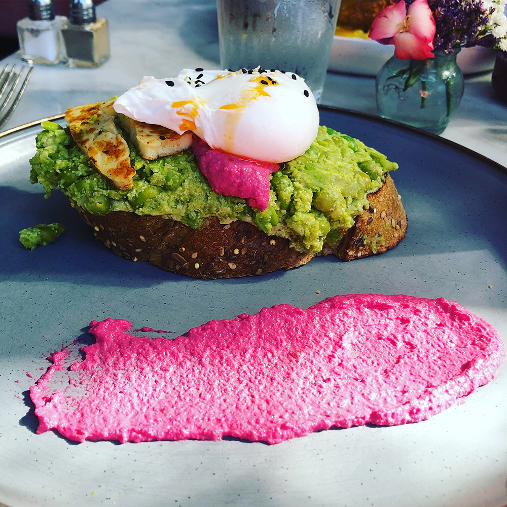 How pretty is this? Smashed peas, poached egg, halloumi, and beet hummus at The Collins Quarter.