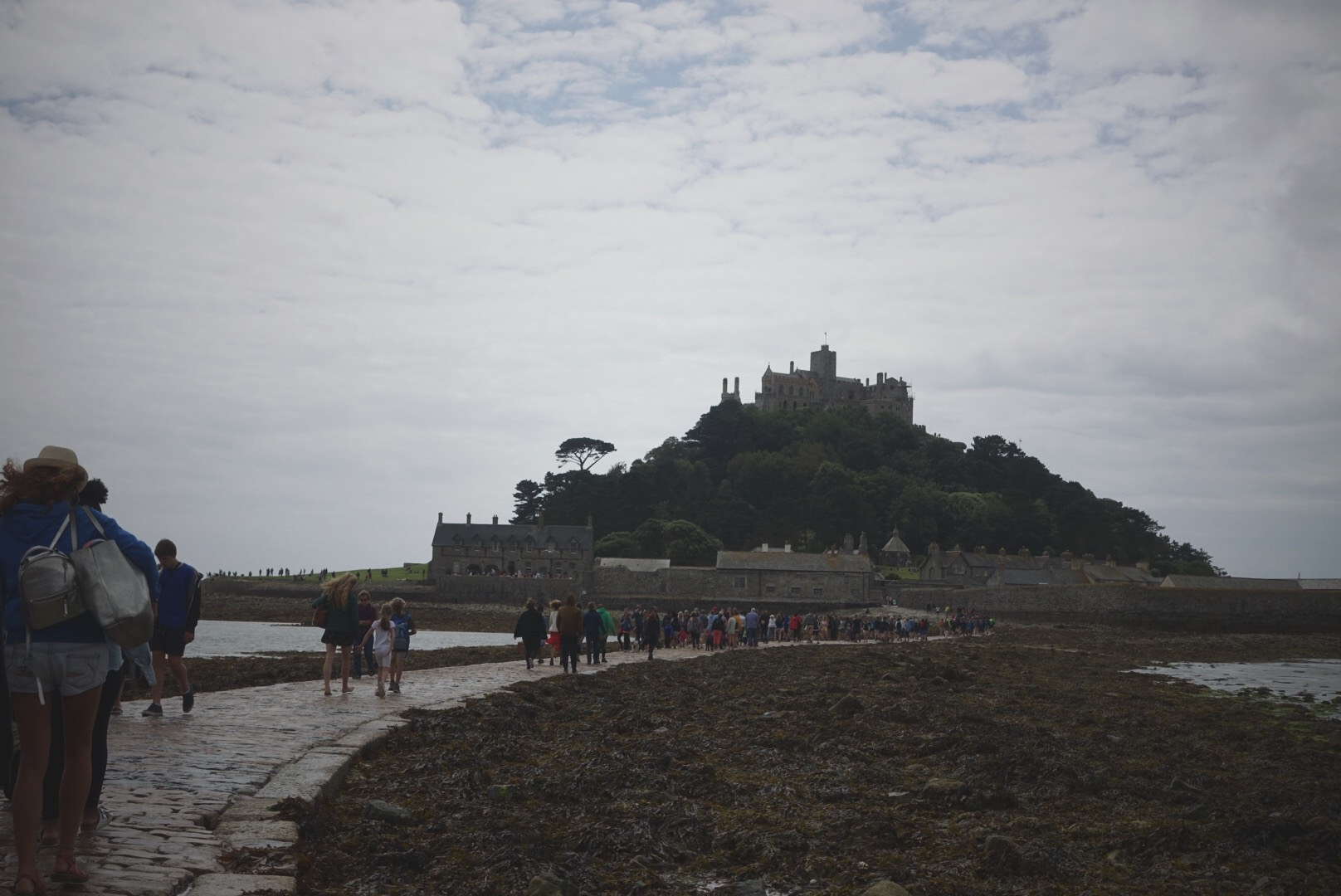 Walking along the causeway to     St. Michael's Mount     while the tide was out. St. Michael's Mount is not to be confused with the much larger     Mont Saint-Michel    , located in France — although there are obviously similarities!