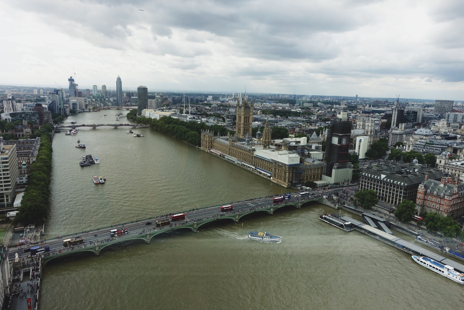 The Thames River, Parliament, and a row of double-decker buses. This might be the most London photo that ever Londoned.