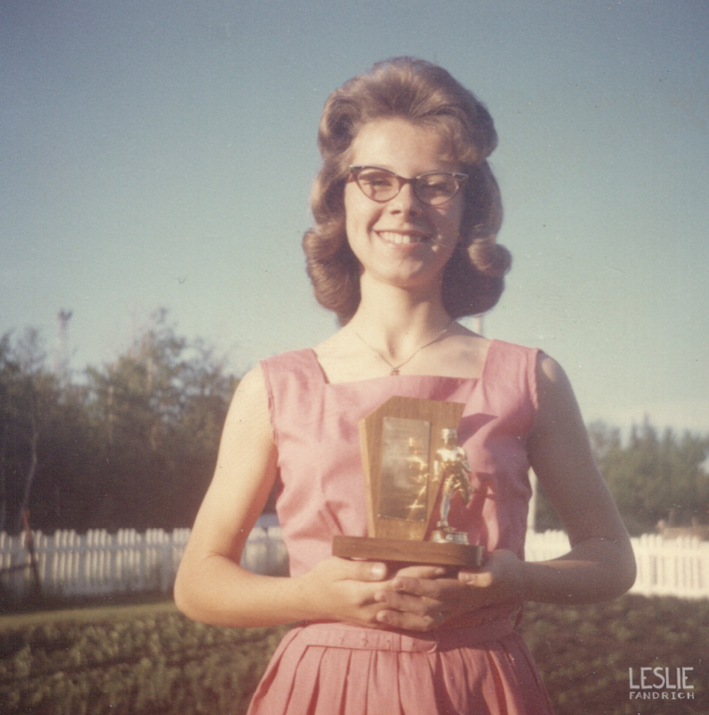 1964 - Fourteen years old. With one of her many track and field trophies.