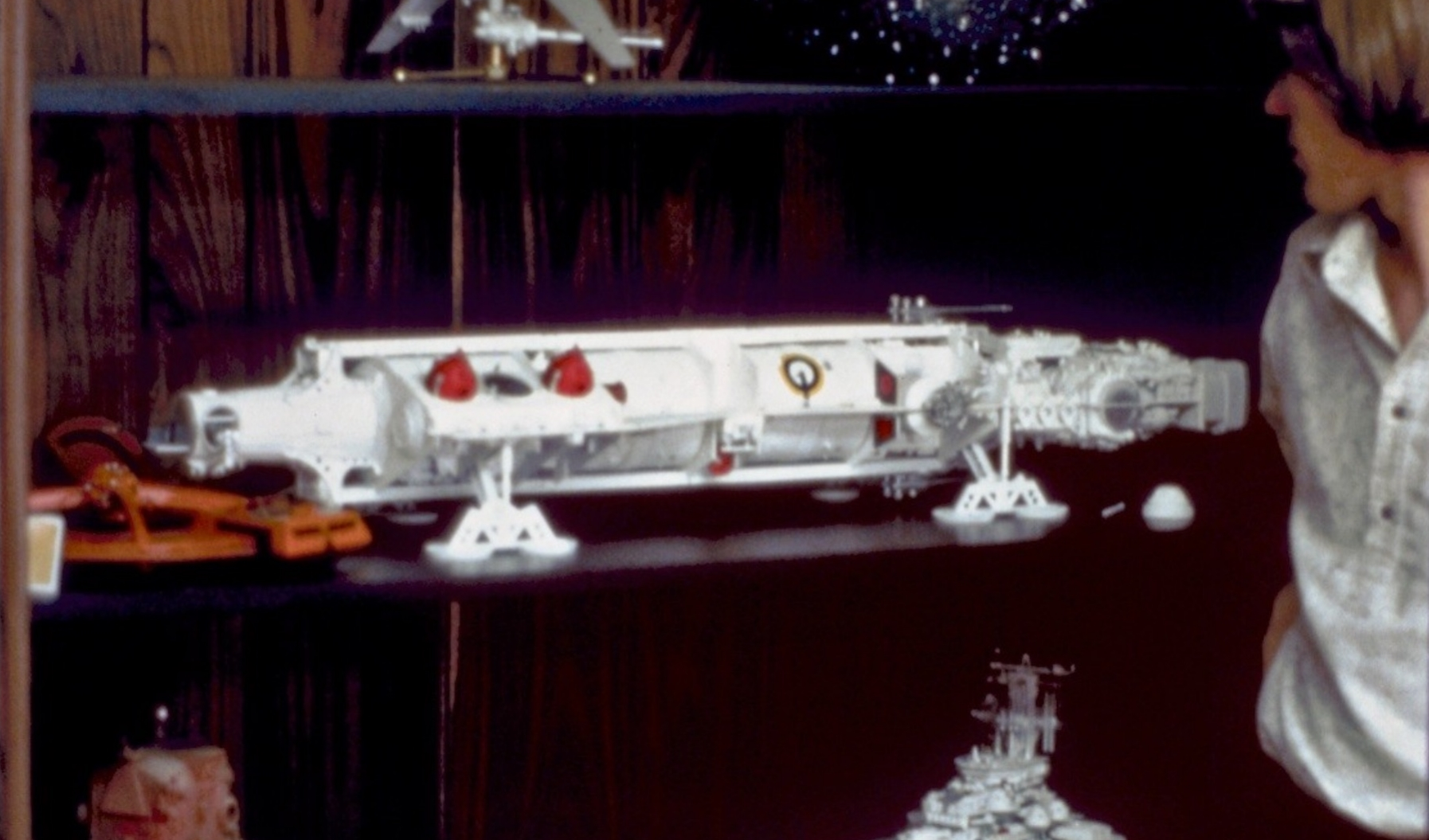 Colin Cantwell's Pirate Ship model, sans cockpit, with Joe Johnston lingering on the sidelines.