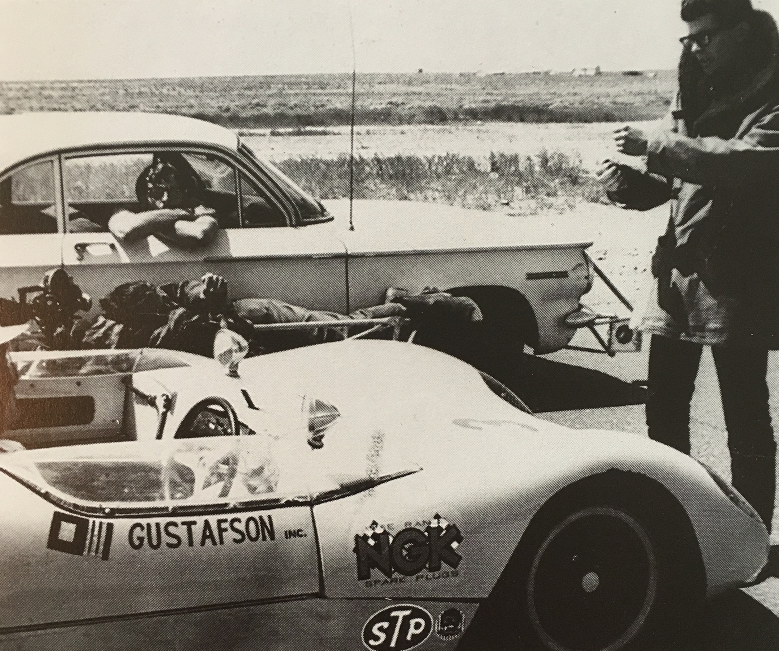 Lucas (circa 22 years old) on location at Willow Springs Raceway filming  1:42.08 . Notice camera operator Emmett Alston strapped to the side of the other car.