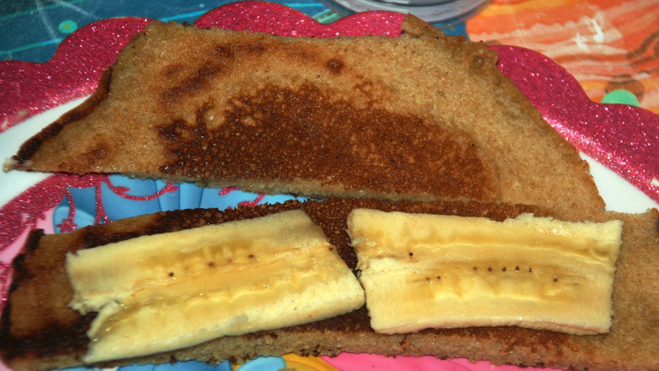 Place sliced bananas on top of pancake strips