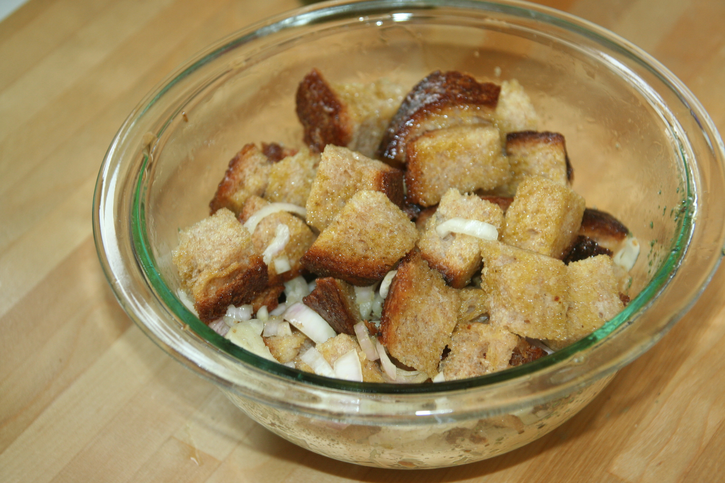 Next, I drizzled the bread with my favorite Frankies 457 olive oil and tossed with a sliced shallot.