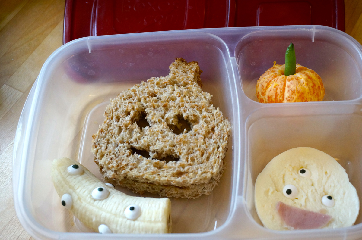 sunbutter and jam pumpkin sandwich, monster-eyed banana, clementine, monster-eyed fresh mozzarella