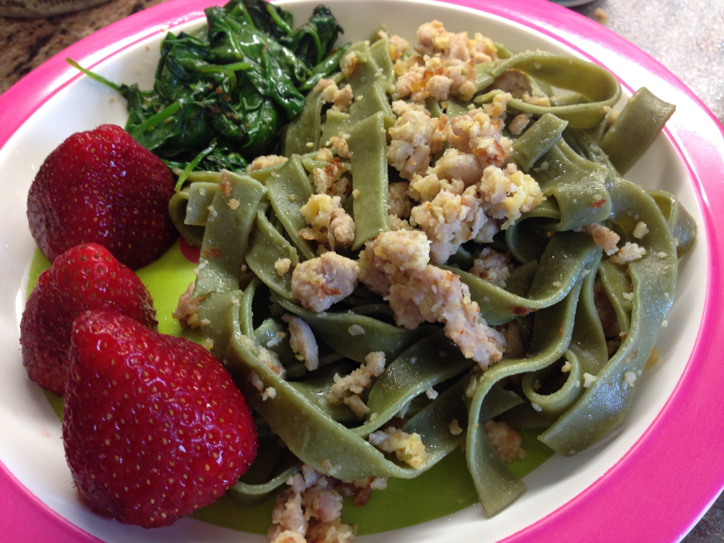 Spinach linguine with deconstructed meatballs, sautéed spinach and strawberries. A really fast dinner!