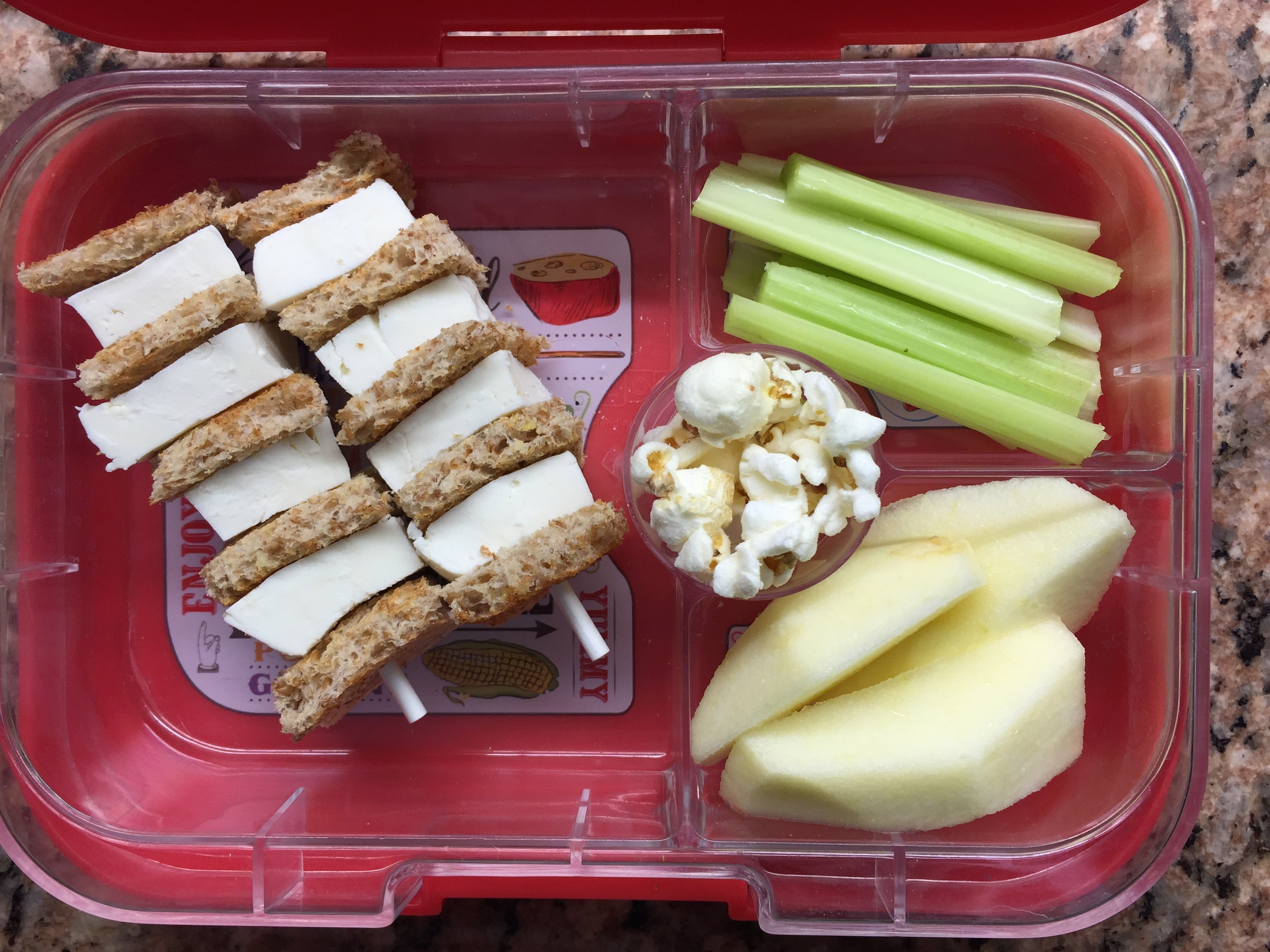 fresh mozzarella sandwich kebabs, celery, apple and popcorn