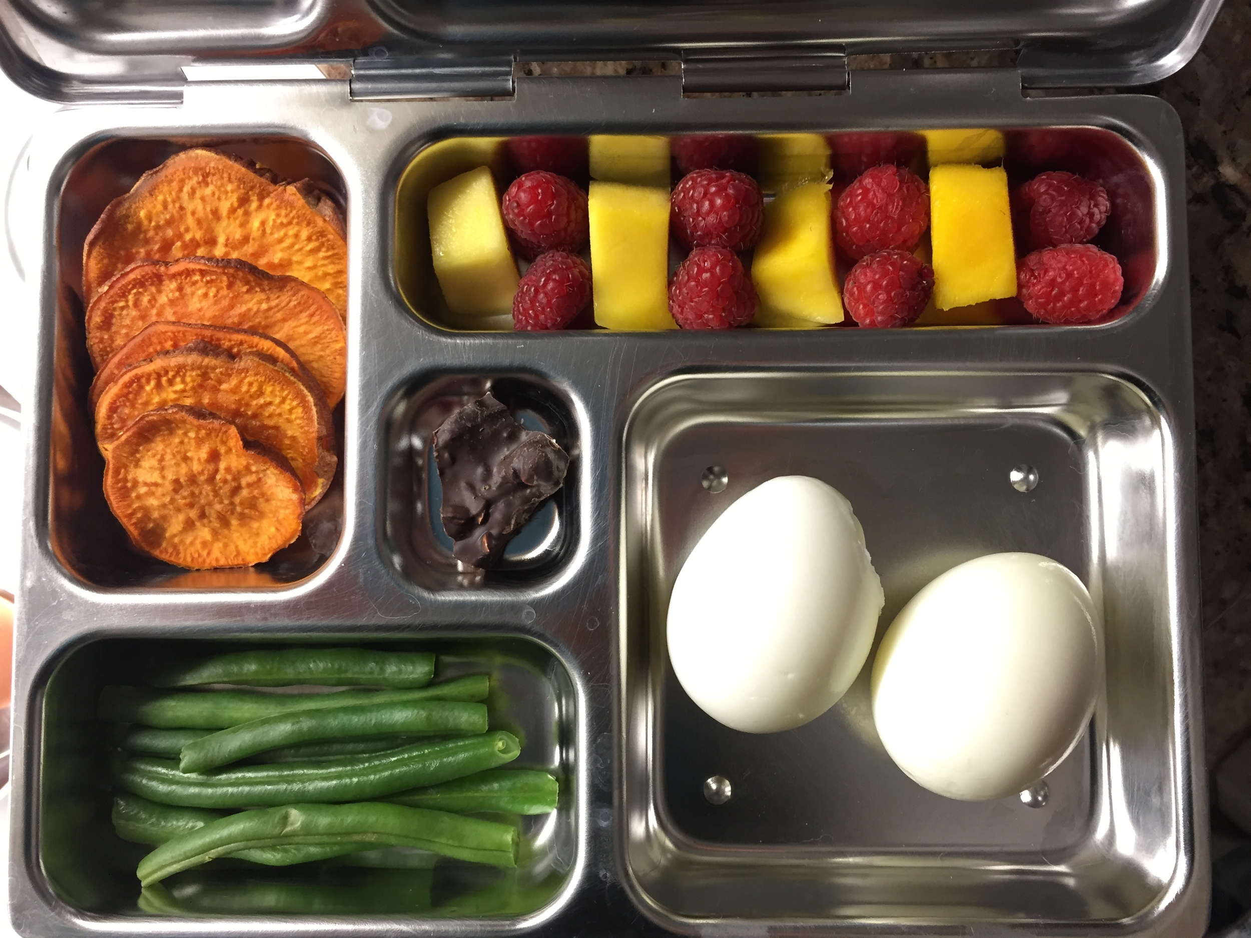 eggs, green beans, roasted sweet potato chips, mango and raspberries, dark chocolate with pretzel
