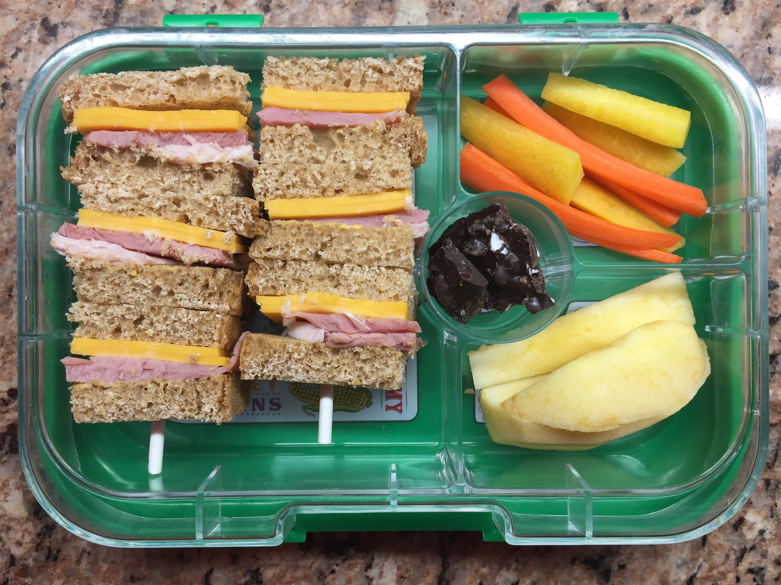 ham and cheese sandwich kebabs, carrot sticks, apple, dark chocolate with mint