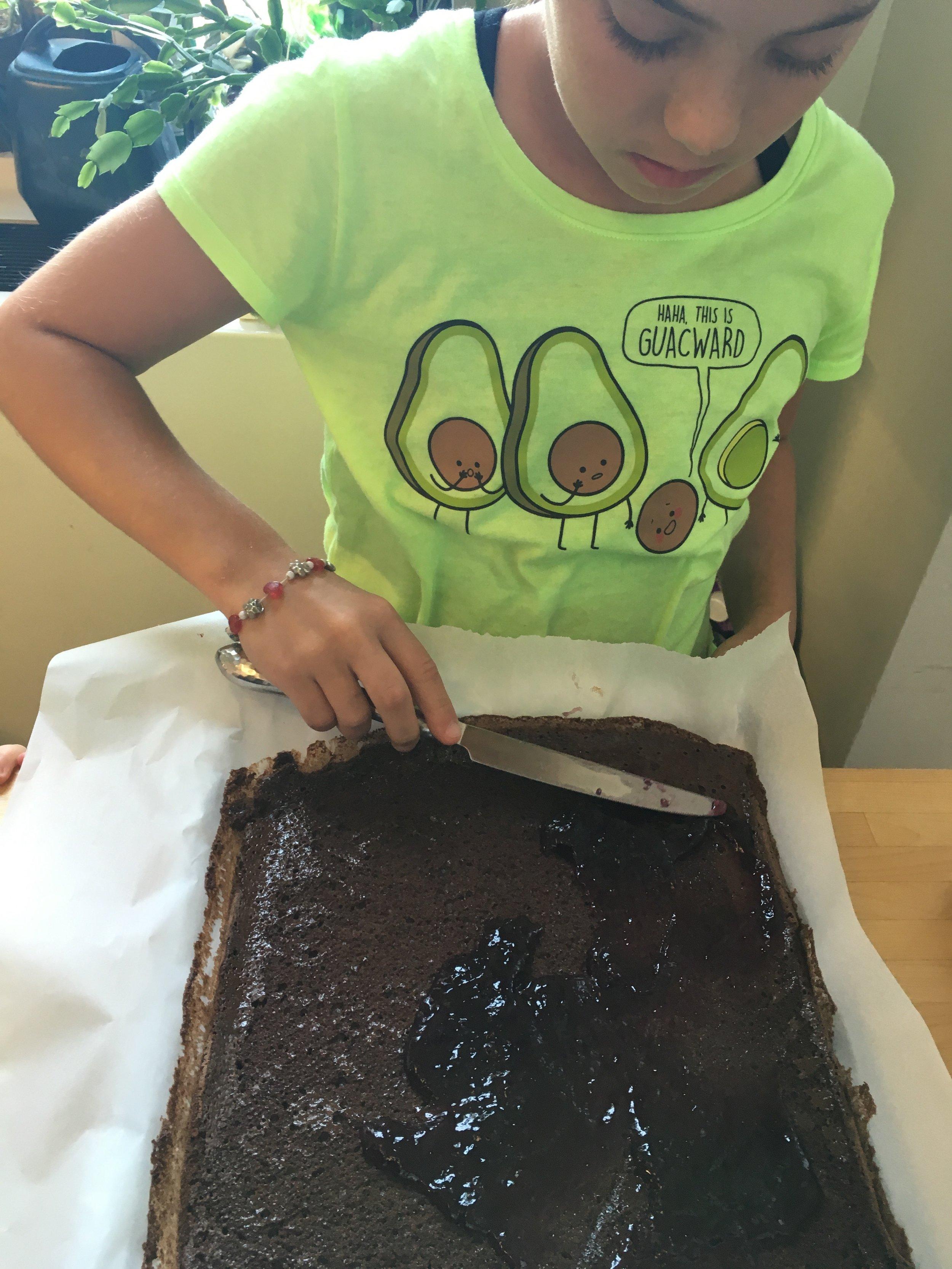 spread jam onto chocolate roll