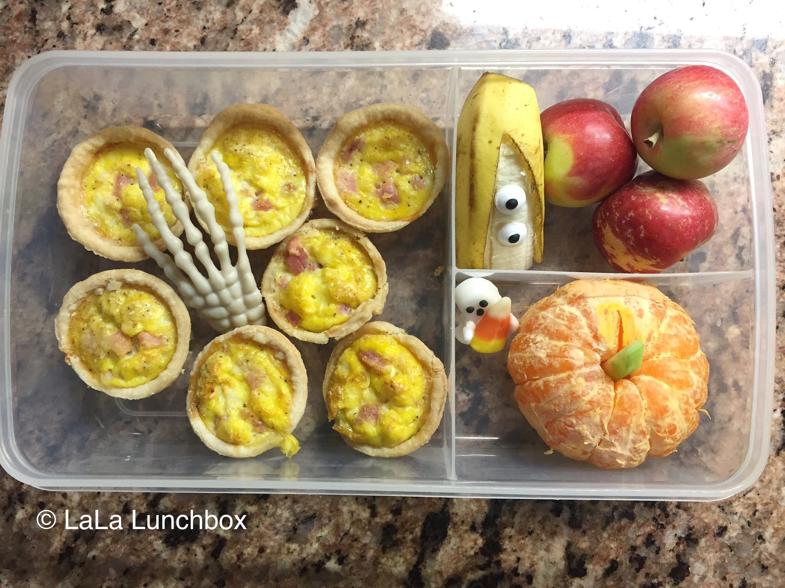 Mini quiche, clementine pumpkins, banana ghost and some mini apples.