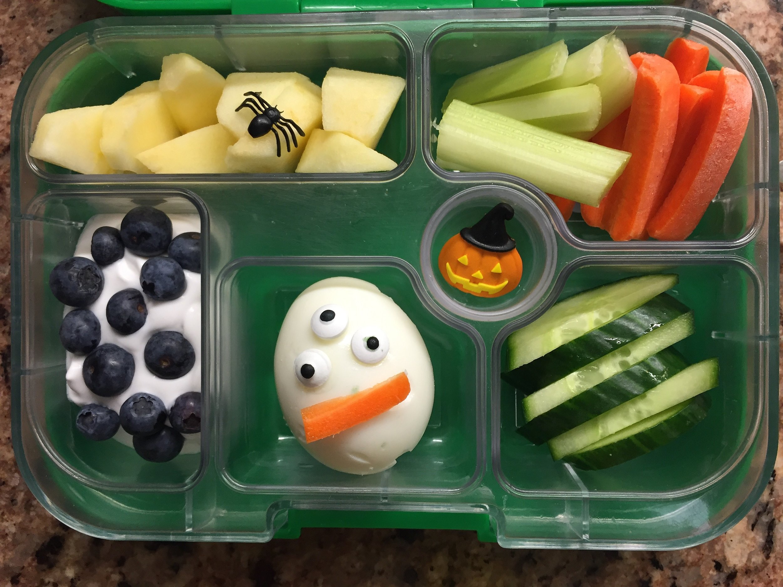Egg monster, veggies, apples with spider, yogurt with blueberries.