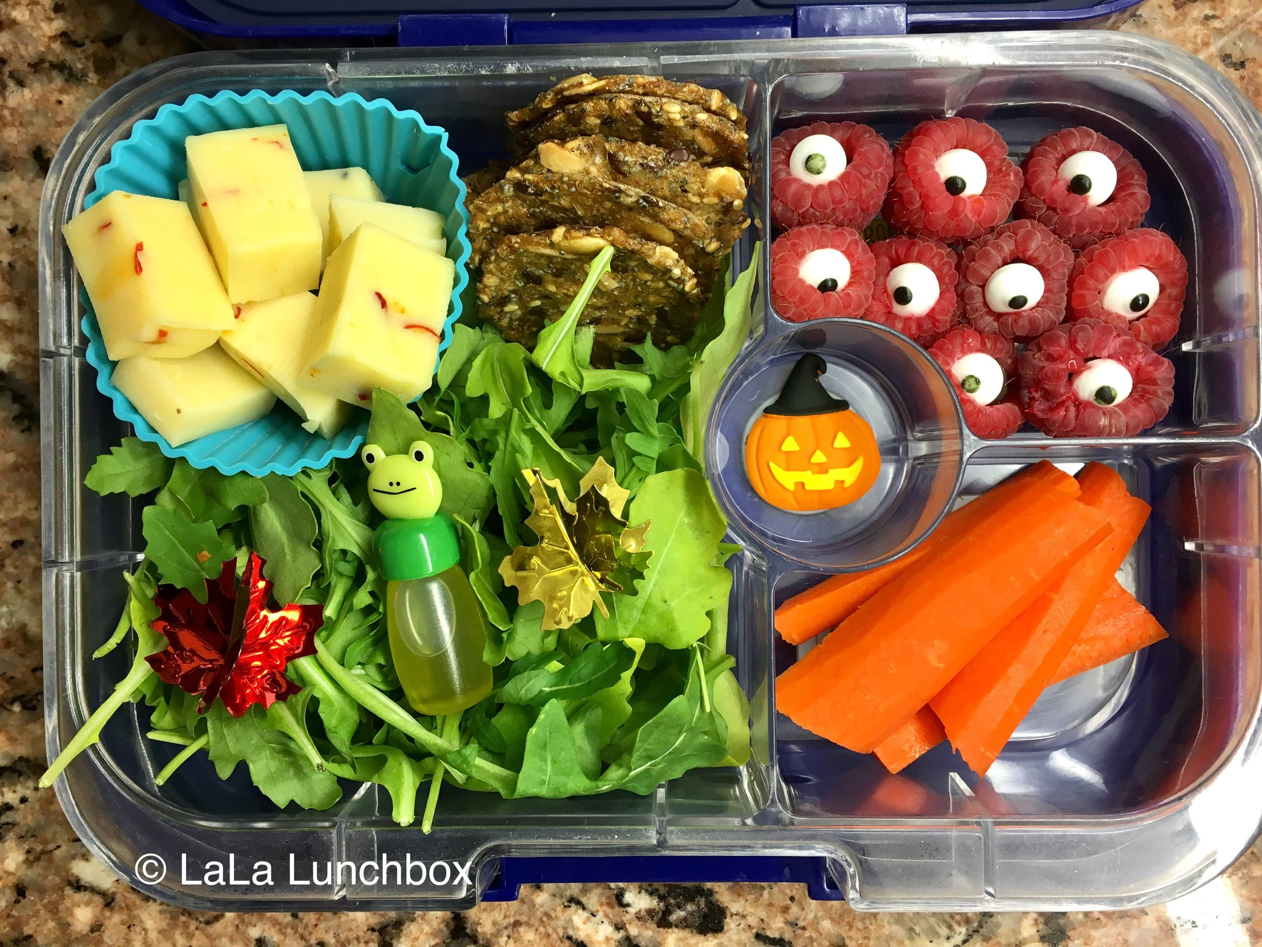 Raspberry eyeballs! Plus salad, cheese and crackers and carrots.