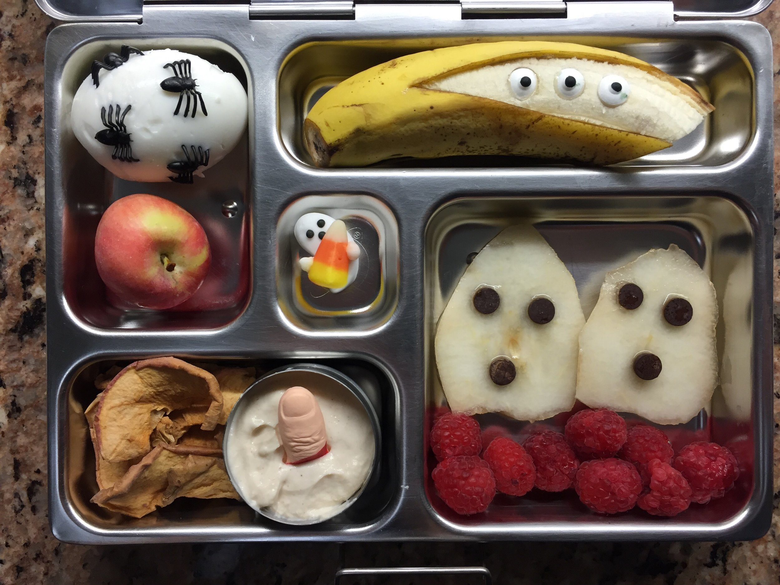 My personal fave: pear ghosts with berries, yogurt with a candy finger and dried apple, spider egg, banana ghost.