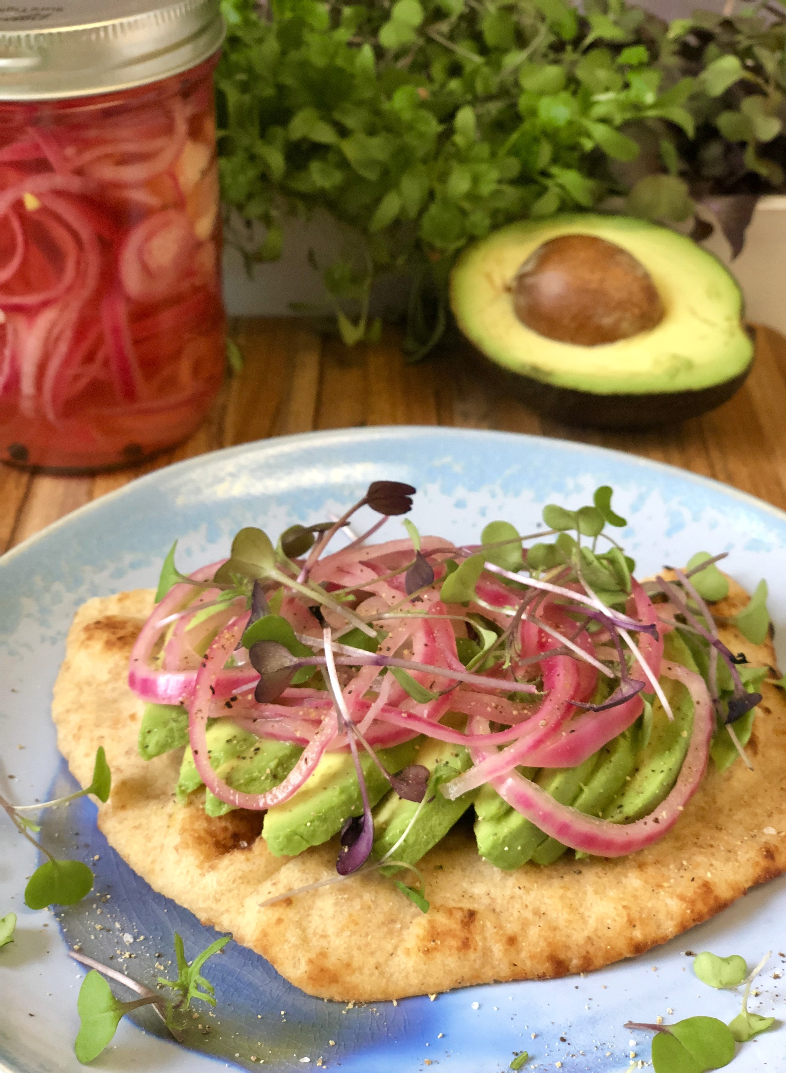 Current obsession: warm naan with avocado, pickled red onion and micro greens