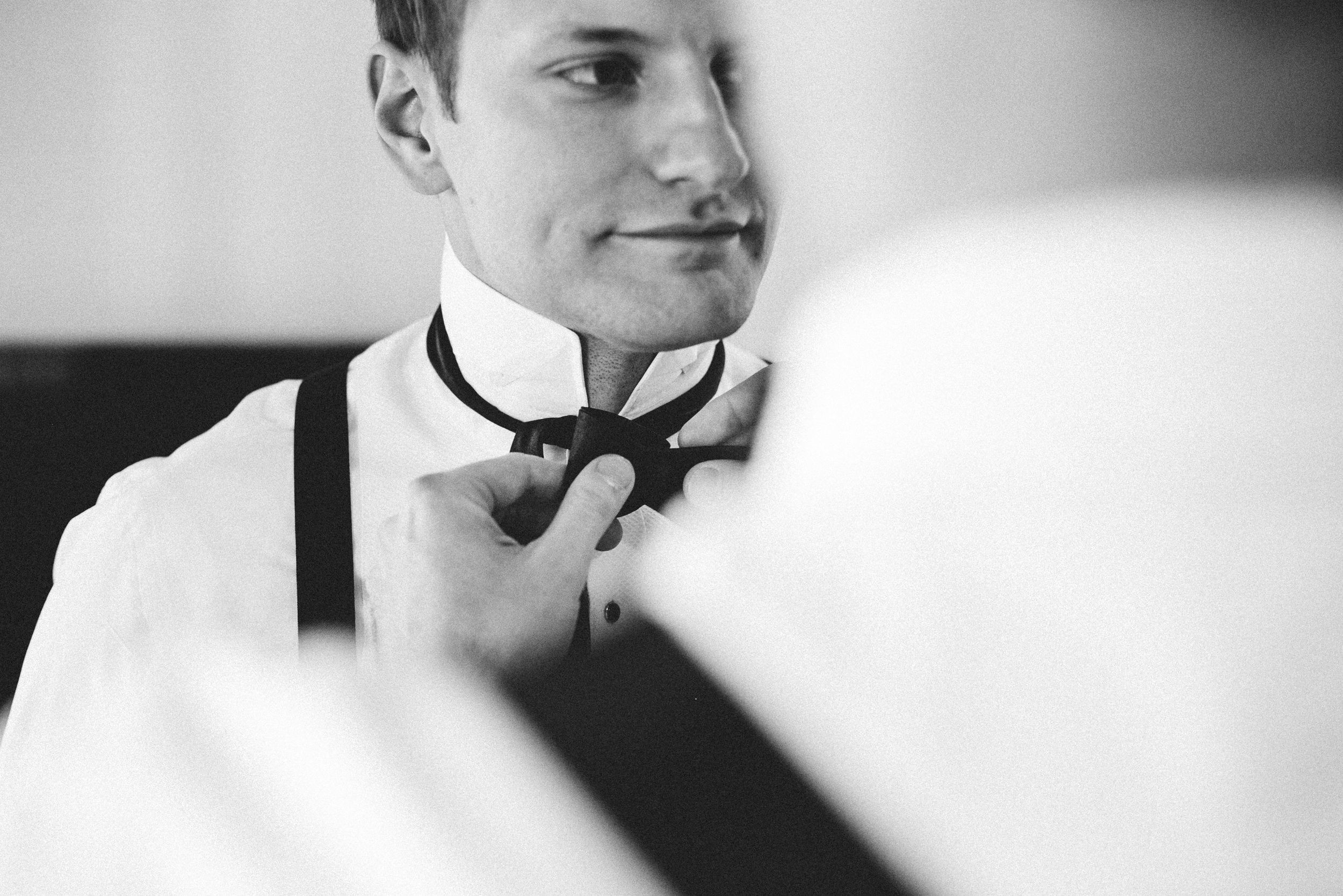 Black and white shot of groom getting ready - Maria Vicencio Photography Weddings