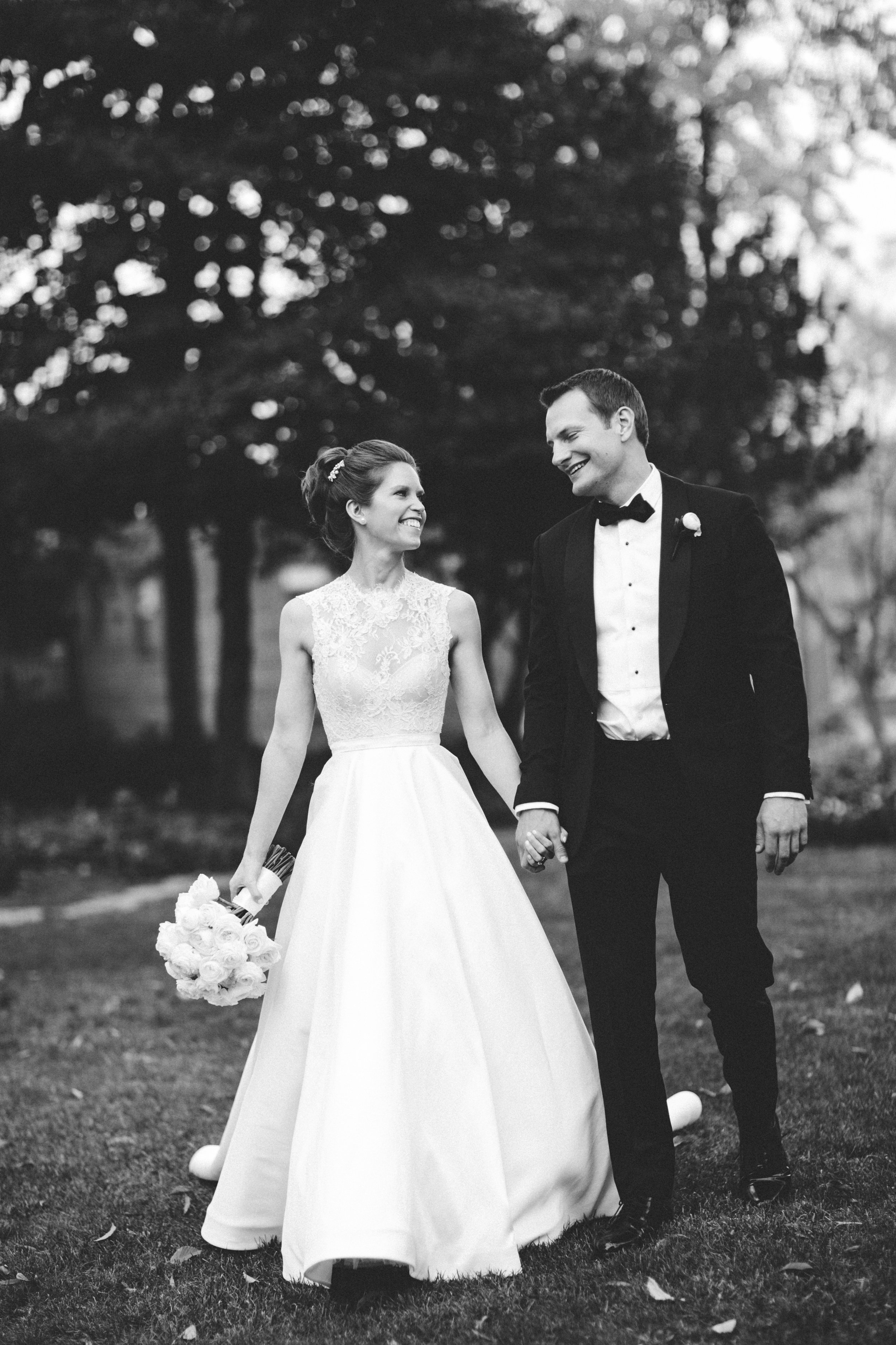Black and white shot of bride and groom walking at Meridian House in DC - Maria Vicencio Photography Weddings