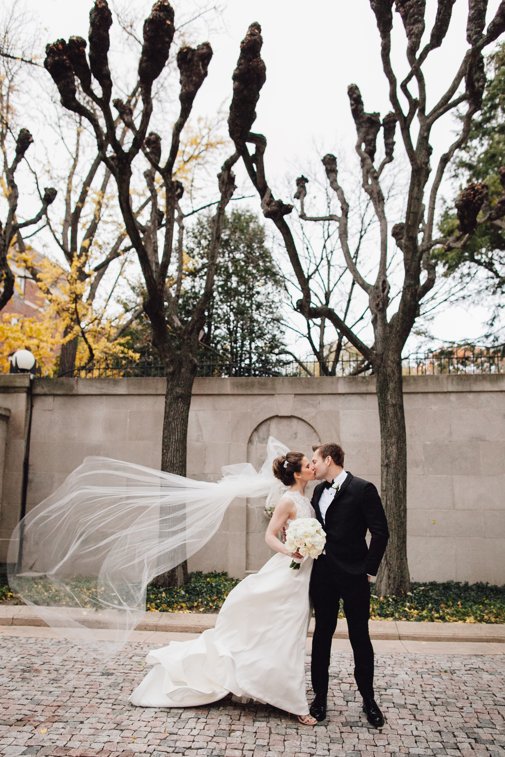 Windy portrait of the bride and groom at Meridian House in DC - Maria Vicencio Photography Weddings