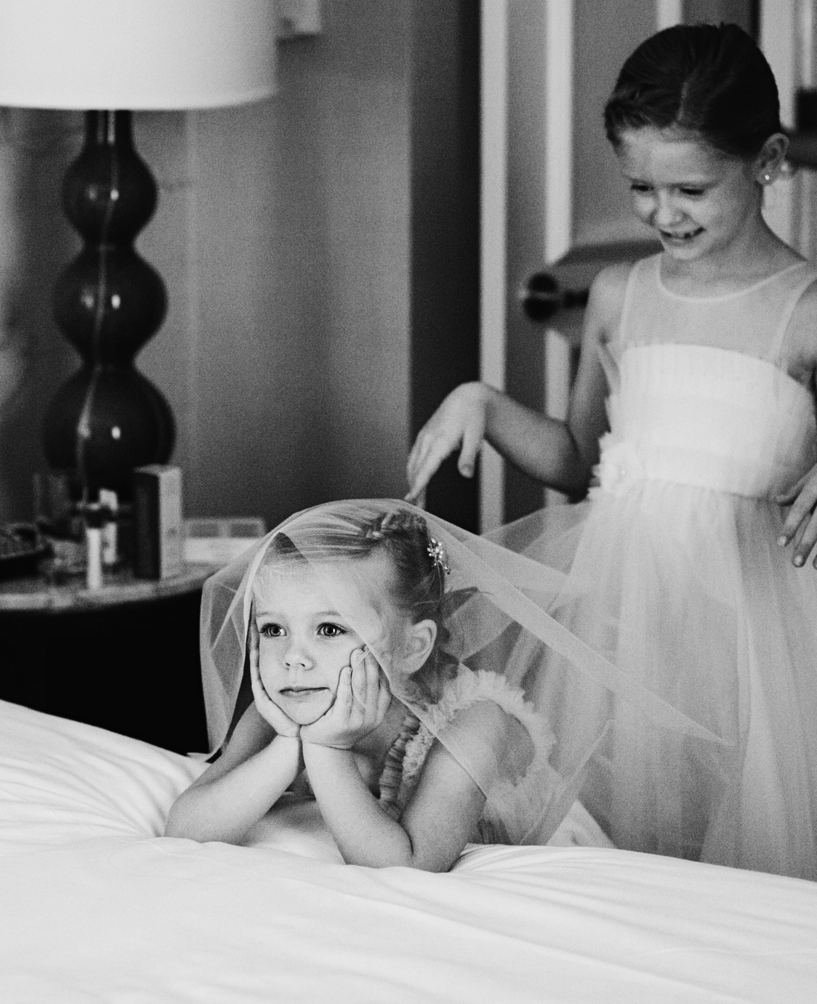 Black and white shot of flower girls waiting for the bride - Maria Vicencio Photography Weddings