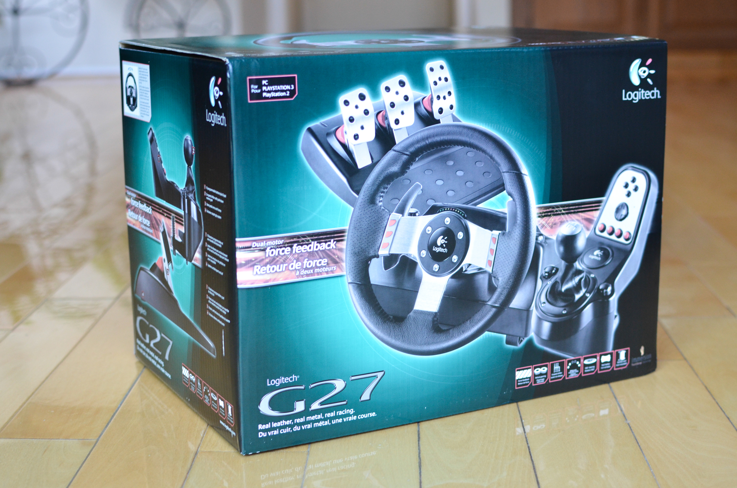 14c987e5a0d The Logitech G27 comes in a massive box that includes the steering wheel,  shifter, pedals, power bricks, and various manuals. My first impression is  that ...
