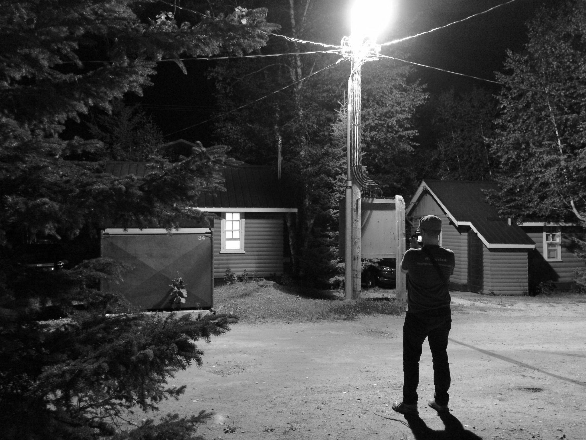 This is Aidan taking a photo of a streetlight at night in Waskesiu.