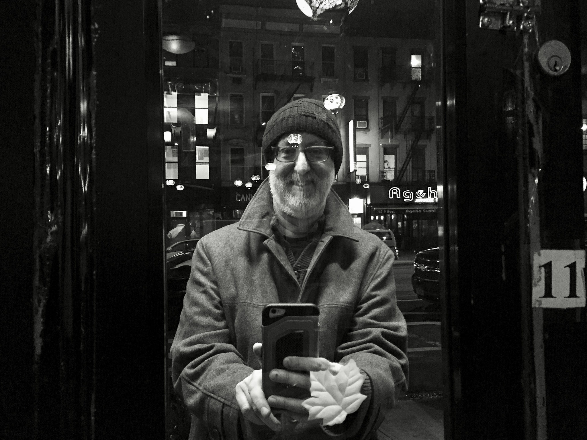 Neil Kramer outside a restaurant window