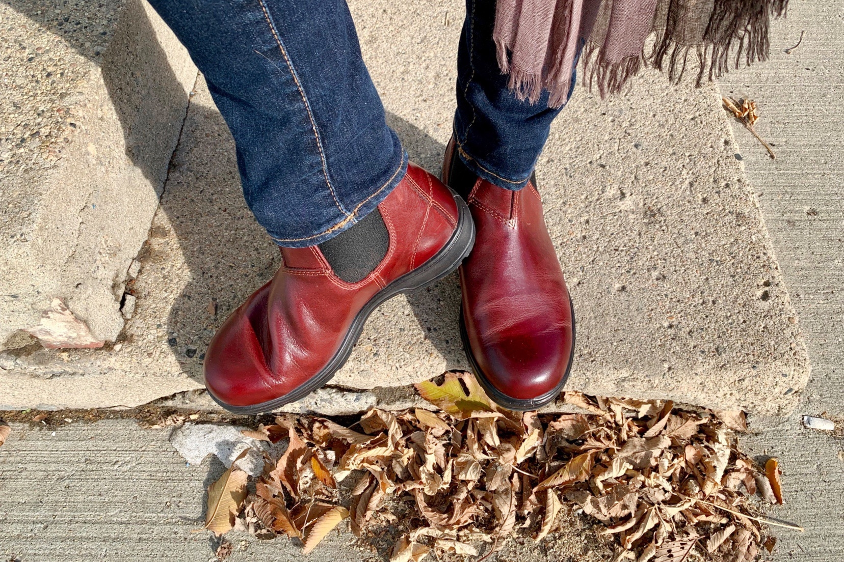 my feet on an old sidewalk showing off a new pair of redwood Blundstone boots