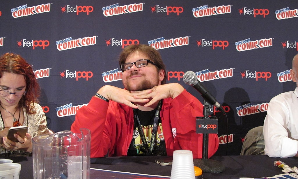 Sam Sykes at New York Comic Con 2014. Photo credit: Docking Bay 93 [ CC BY 2.0 ],  via Wikimedia Commons .