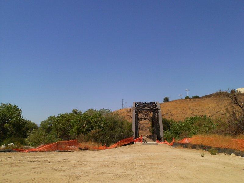BRIDGE AND RIVER VEGETATION PROVIDE THE DESIGN CONTEXT