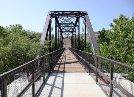 REFINISHED BRIDGE WITH SAFETY RAILS
