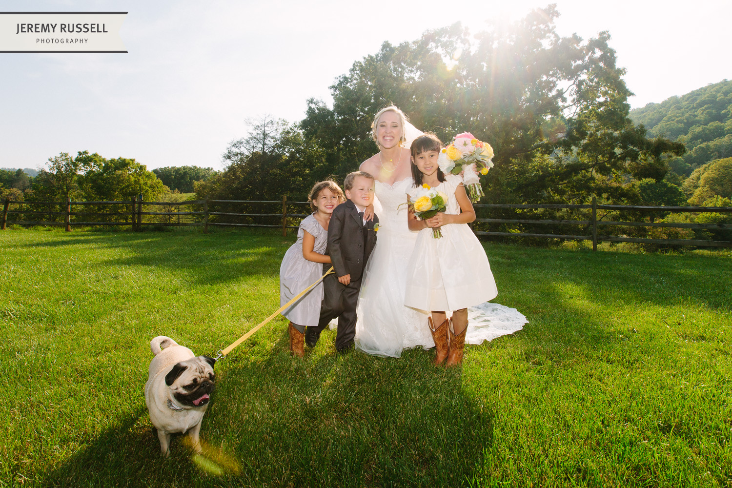 Bride with kids in field