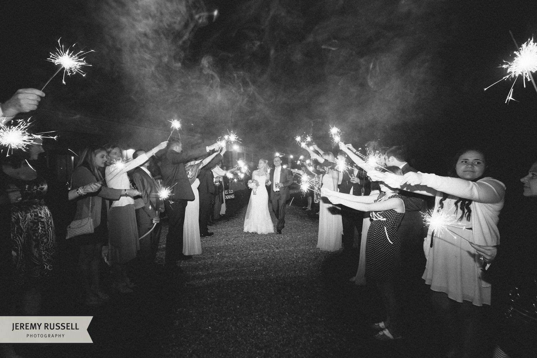 Bride and groom exit Claxton Farm