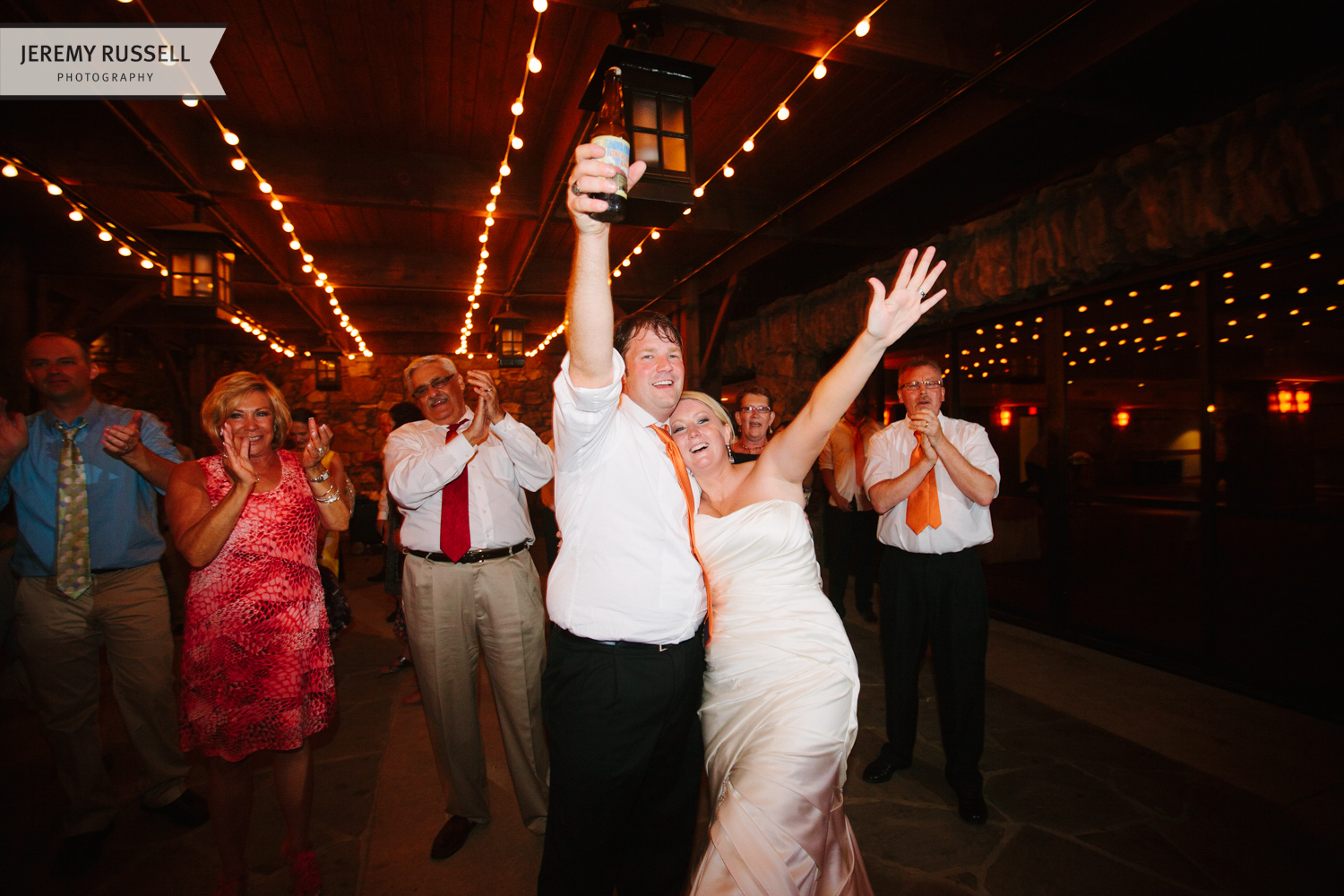Bride and groom cheer for The Business band