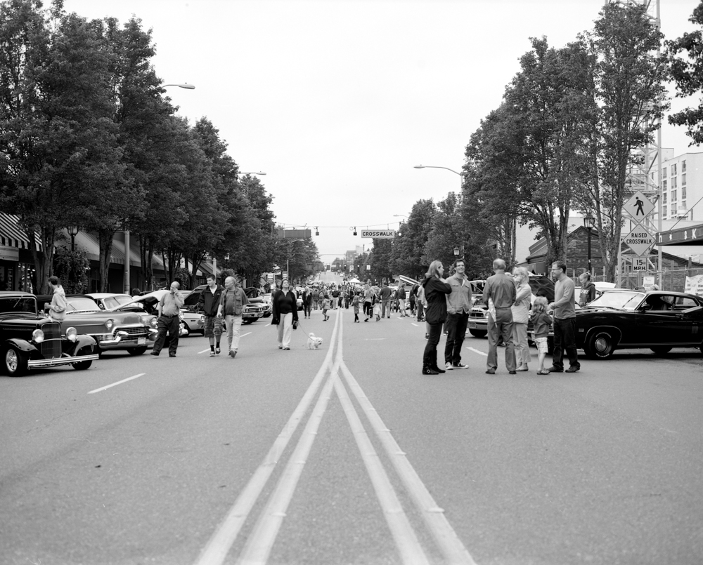 Street view of the car show beginning to wind down. Image taken with Mamiya RB67 + Fujifilm Acros Neopan 100 and developed in Ilford Ilfosol 3.