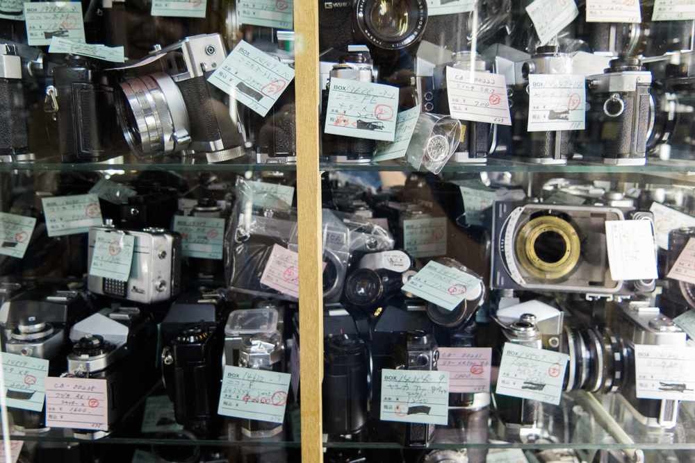 Piles of old film cameras