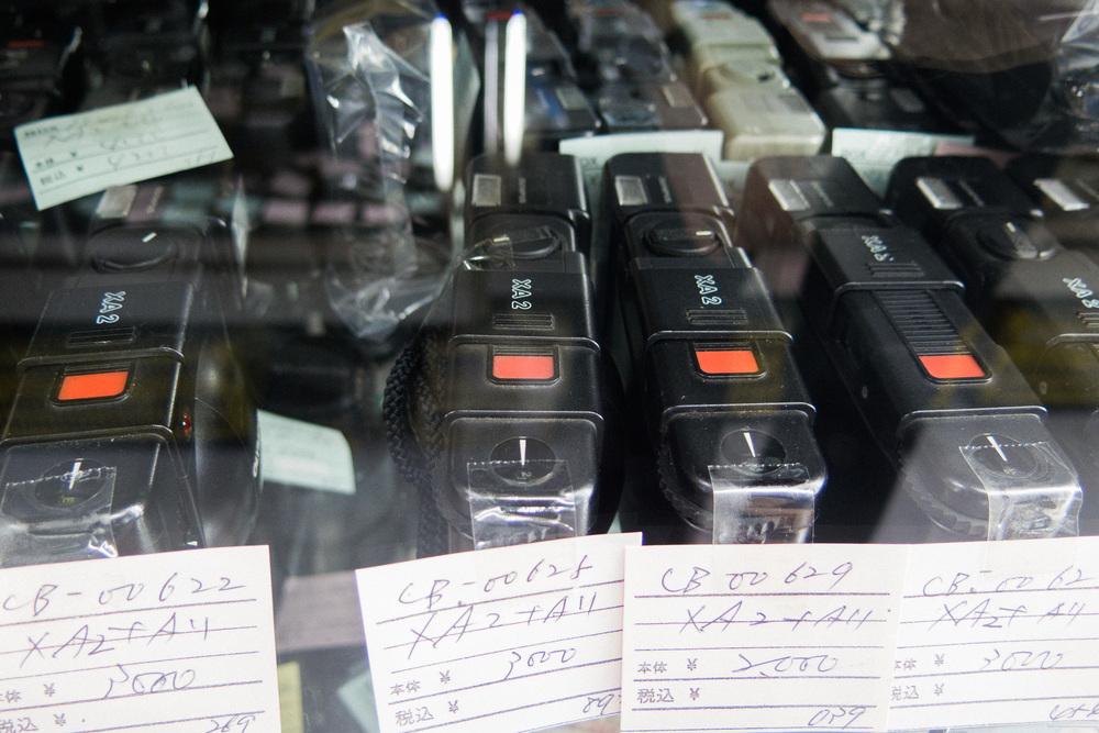 Tons of Olympus XA2 cameras